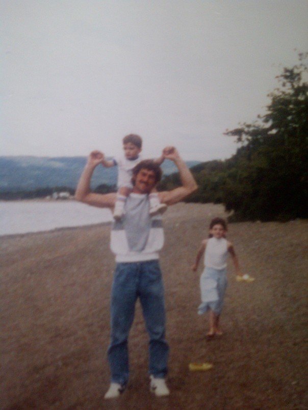 Dad - The Loving Father. Giving me a shoulder ride, as we walk the beach with my sister
