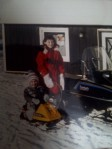 My sister likely taking me for a ride on my ski-doo, pictured next to Dad's pride - his Bravo!
